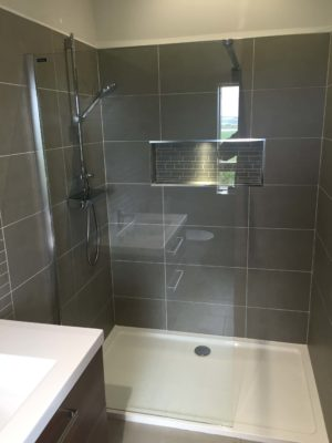 modern shower with grey tiles