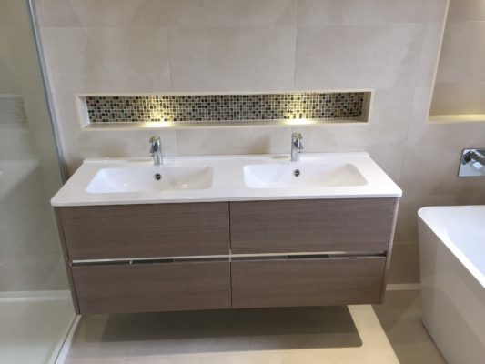 mordern double sink with dark wood drawers & inset shelve