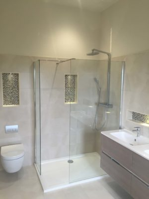 New bathroom with large glass shower enclosure